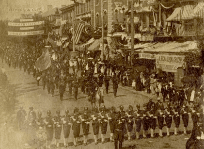Black and white photo of a parade with marching soldiers