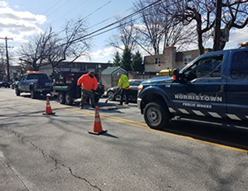 Norristown Public Works Vehicle Working on Road