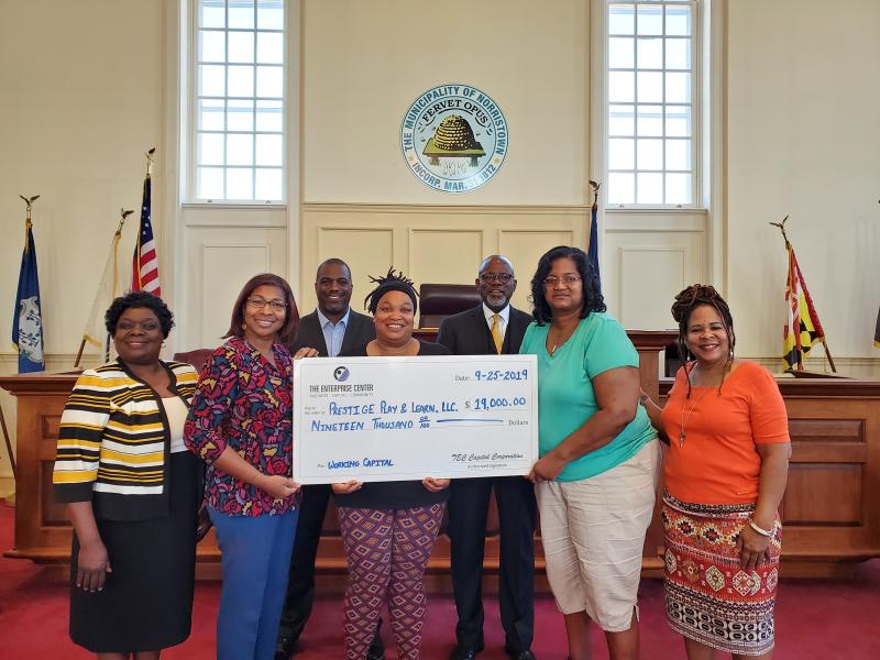 Over sized Check Presentation to day care owners for expansion group of seven
