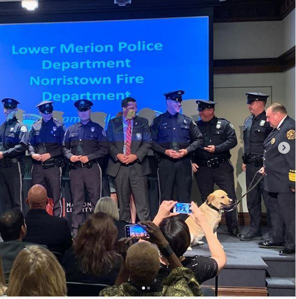 A group of policemen and the chief of fire for norristown awarded